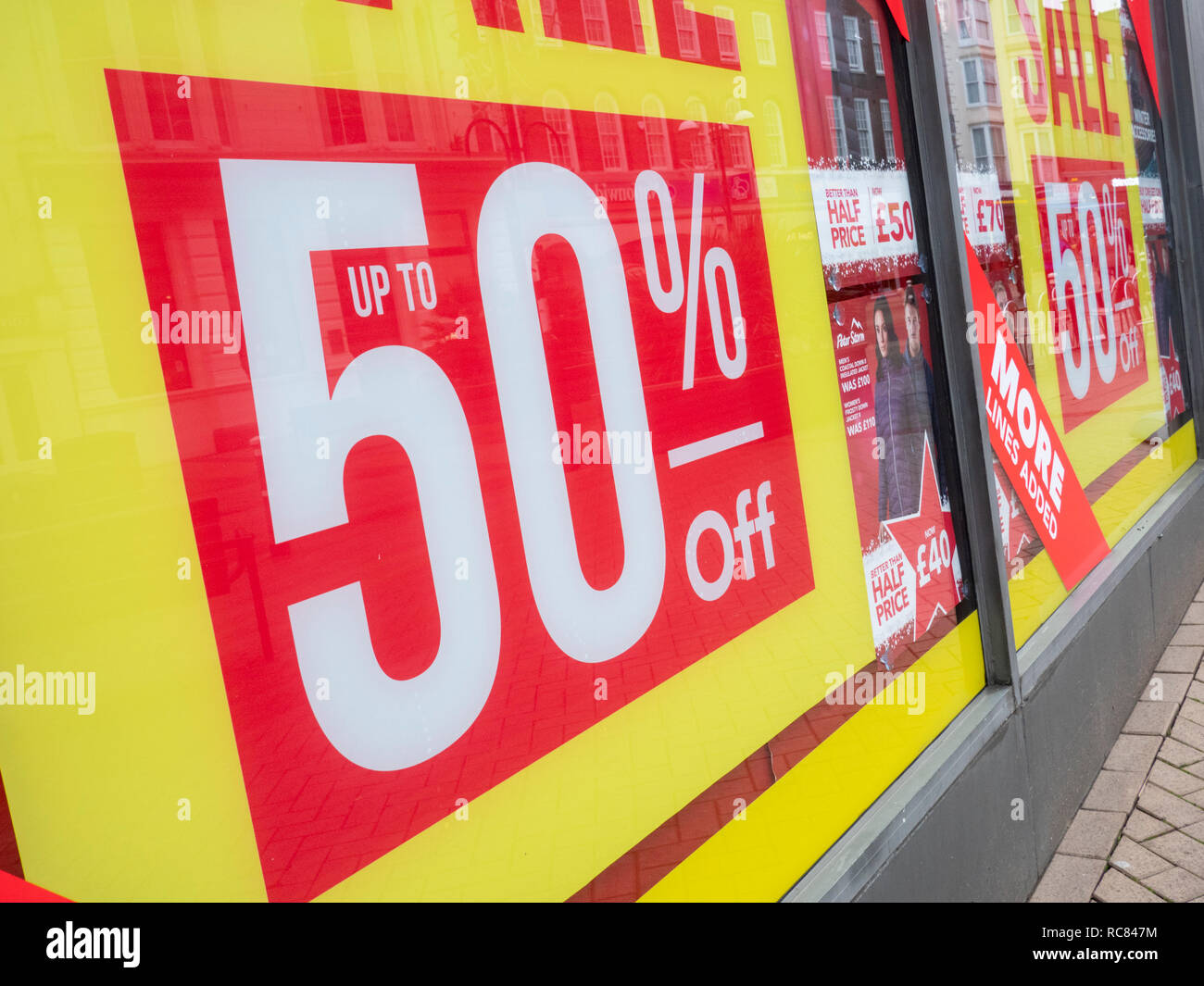 Sale and reduction posters on Blacks outdoor shop Hastings East Sussex UK - Stock Image