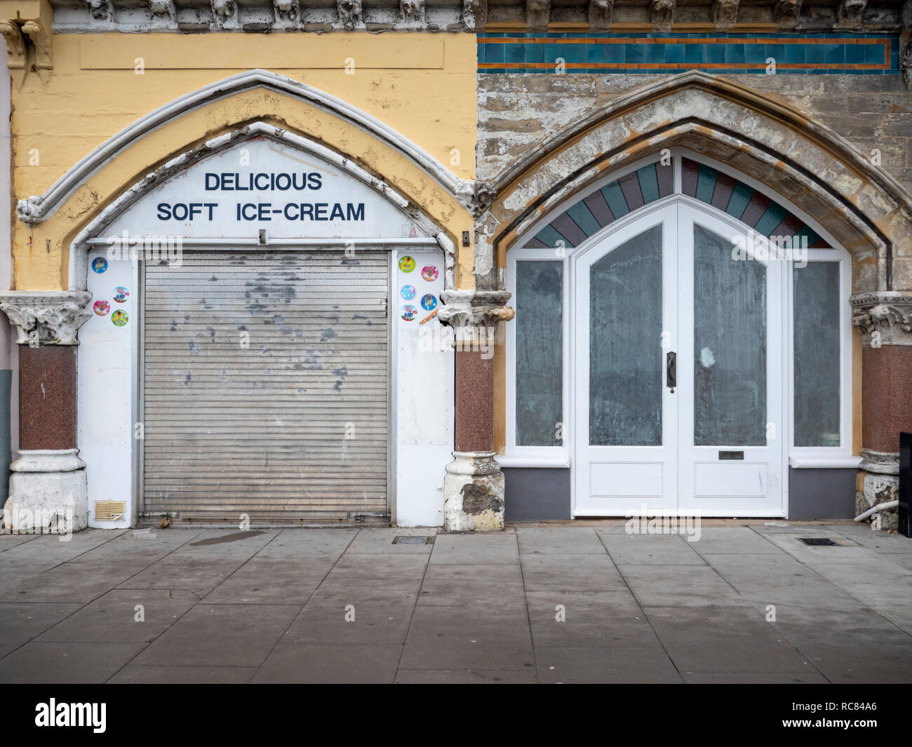 Closed ice cream shops and an empty shop out of season in Hastings East Sussex UK - Stock Image