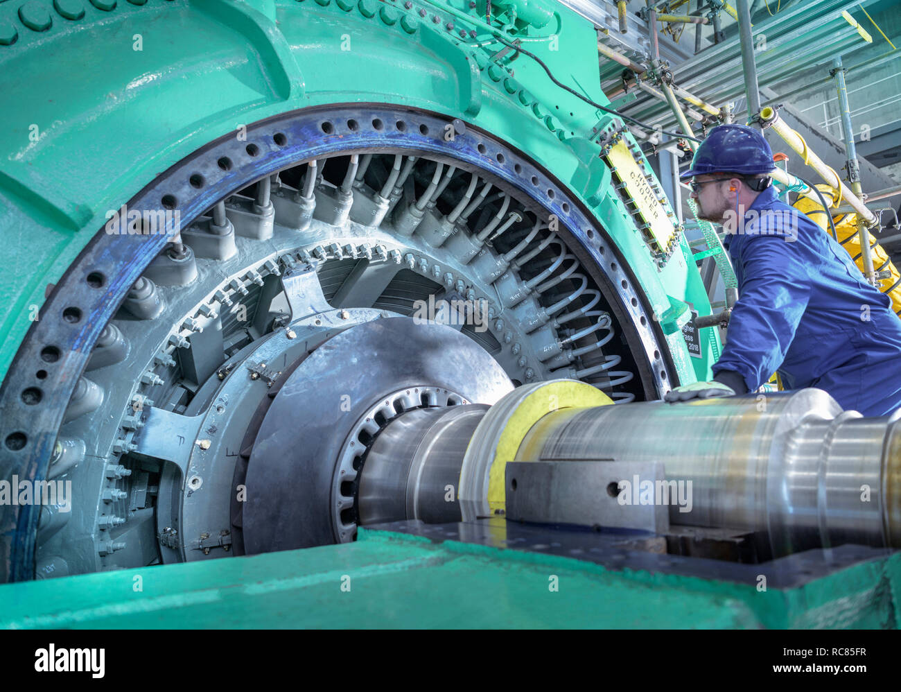 Engineer inspecting generator in nuclear power station during outage Stock Photo