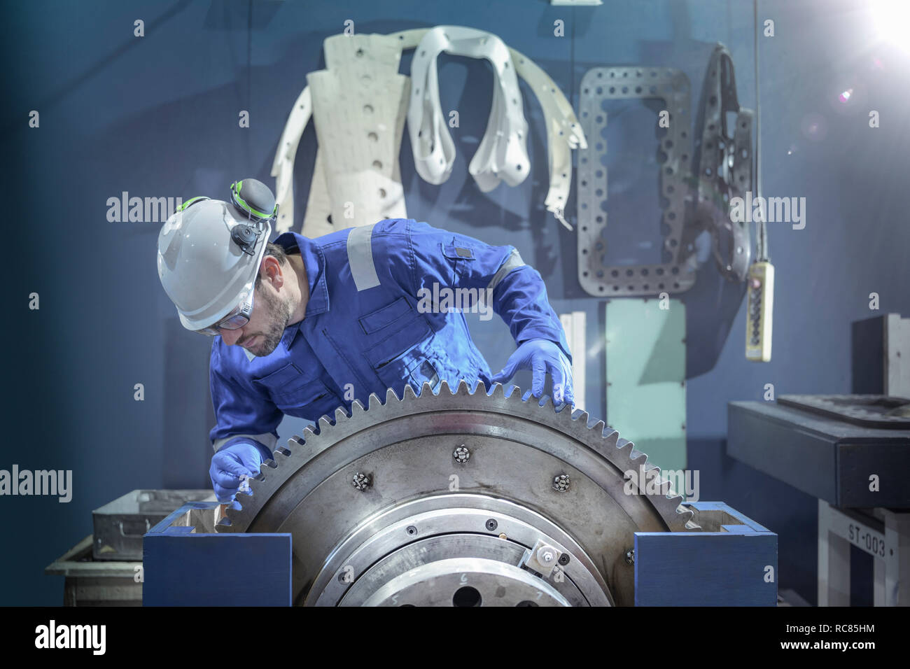 Engineer inspecting large gear during outage in nuclear power station Stock Photo