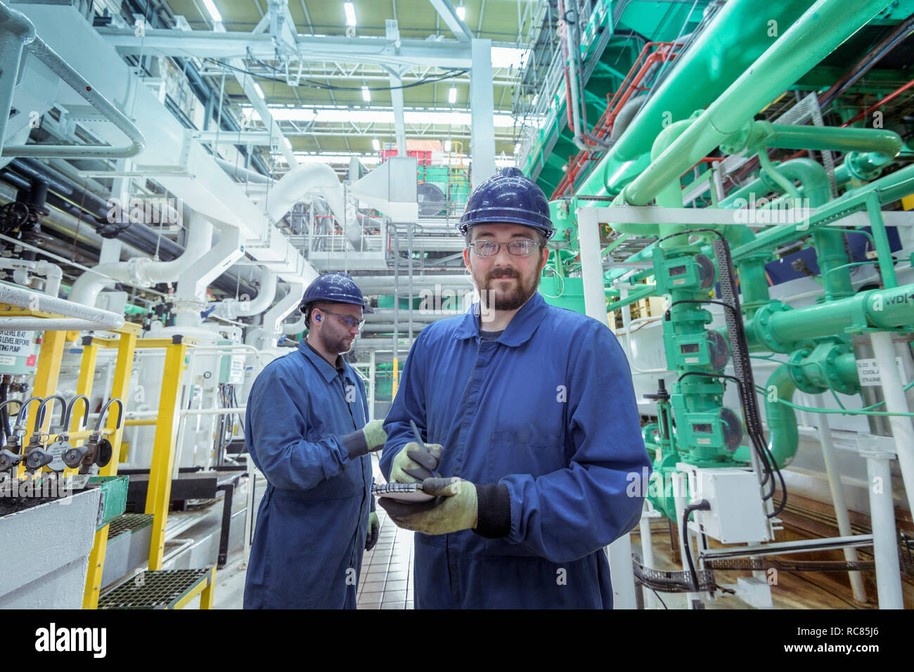 Portrait of engineer in turbine hall in nuclear power station - Stock Image