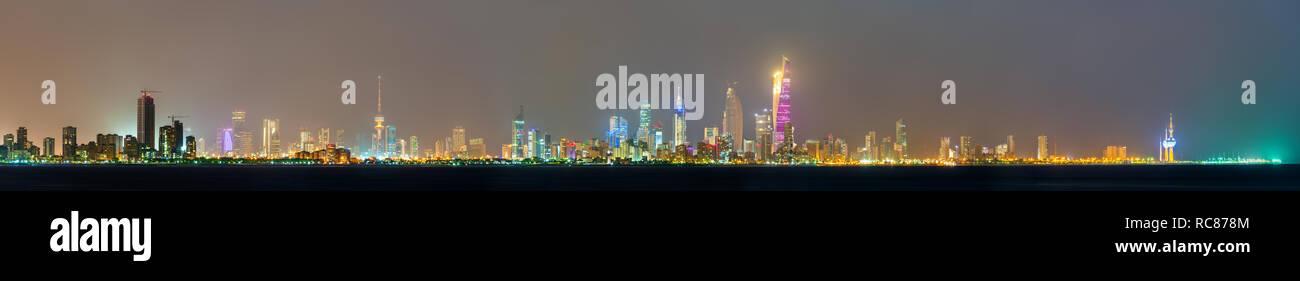 Night skyline of Kuwait City - Stock Image