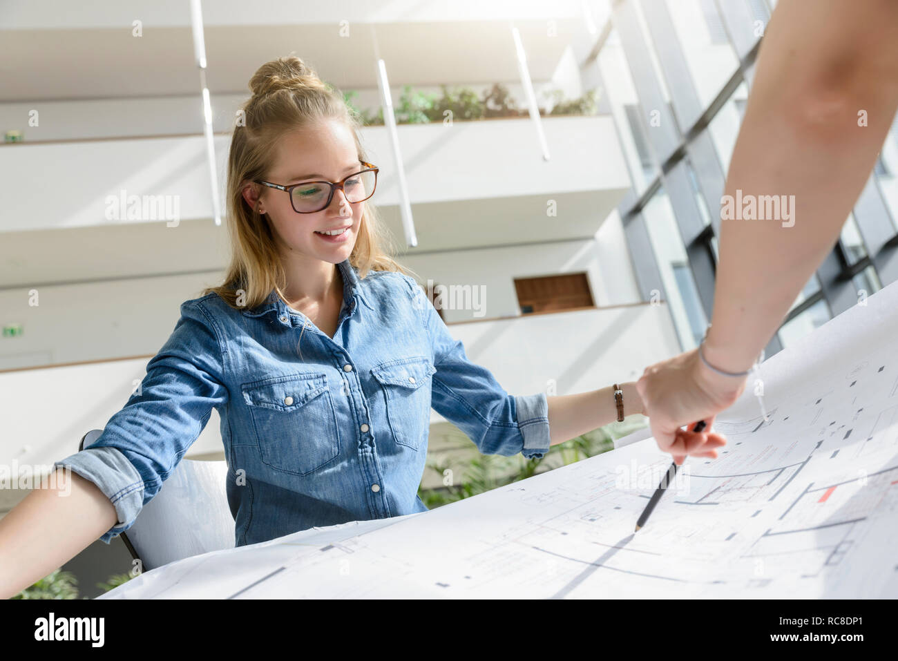 Colleagues brainstorming over charts in bright sunlight Stock Photo