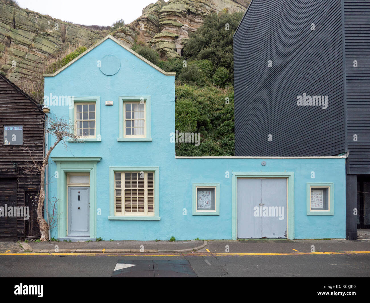 Colourful houses and buildings in blue and black at Rock a Nore Road Hastings East Sussex UK - Stock Image
