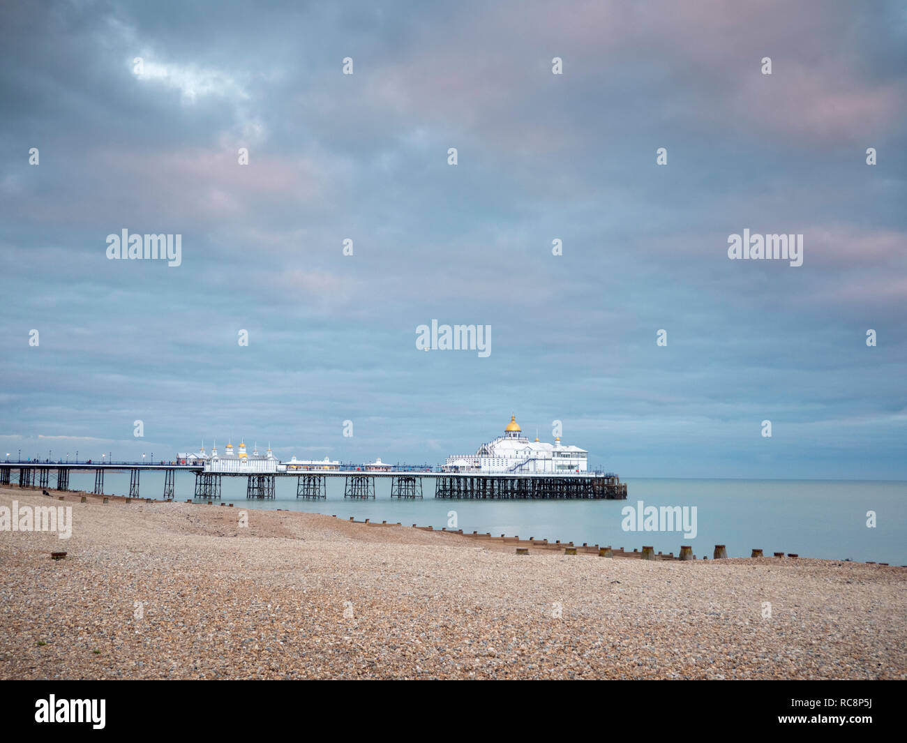Eastbourne Pier in muted colours in winter at dusk, Eastbourne East Sussex UK Stock Photo