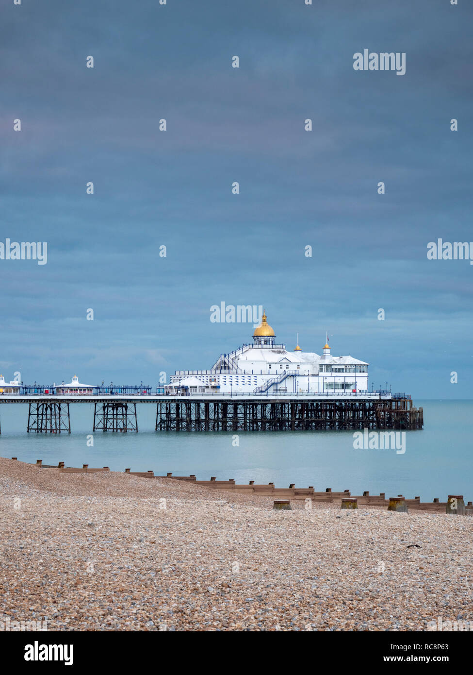 Eastbourne Pier in muted colours in winter at dusk, Eastbourne East Sussex UK - Stock Image