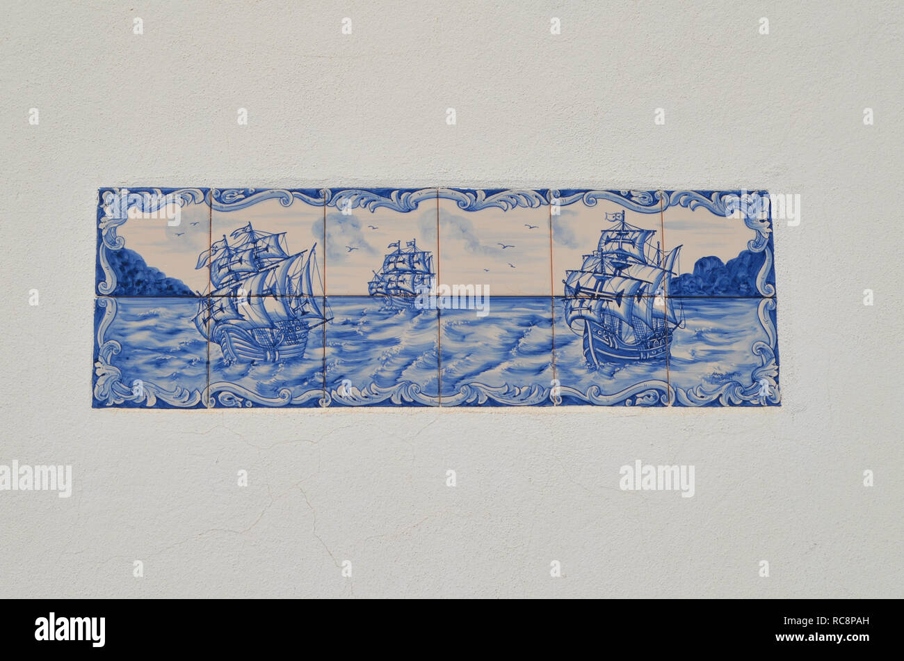 Traditional tiles in a street of Vila do Bispo (Algarve, Southern Portugal) representing the Portuguese Age of Discovery - Stock Image