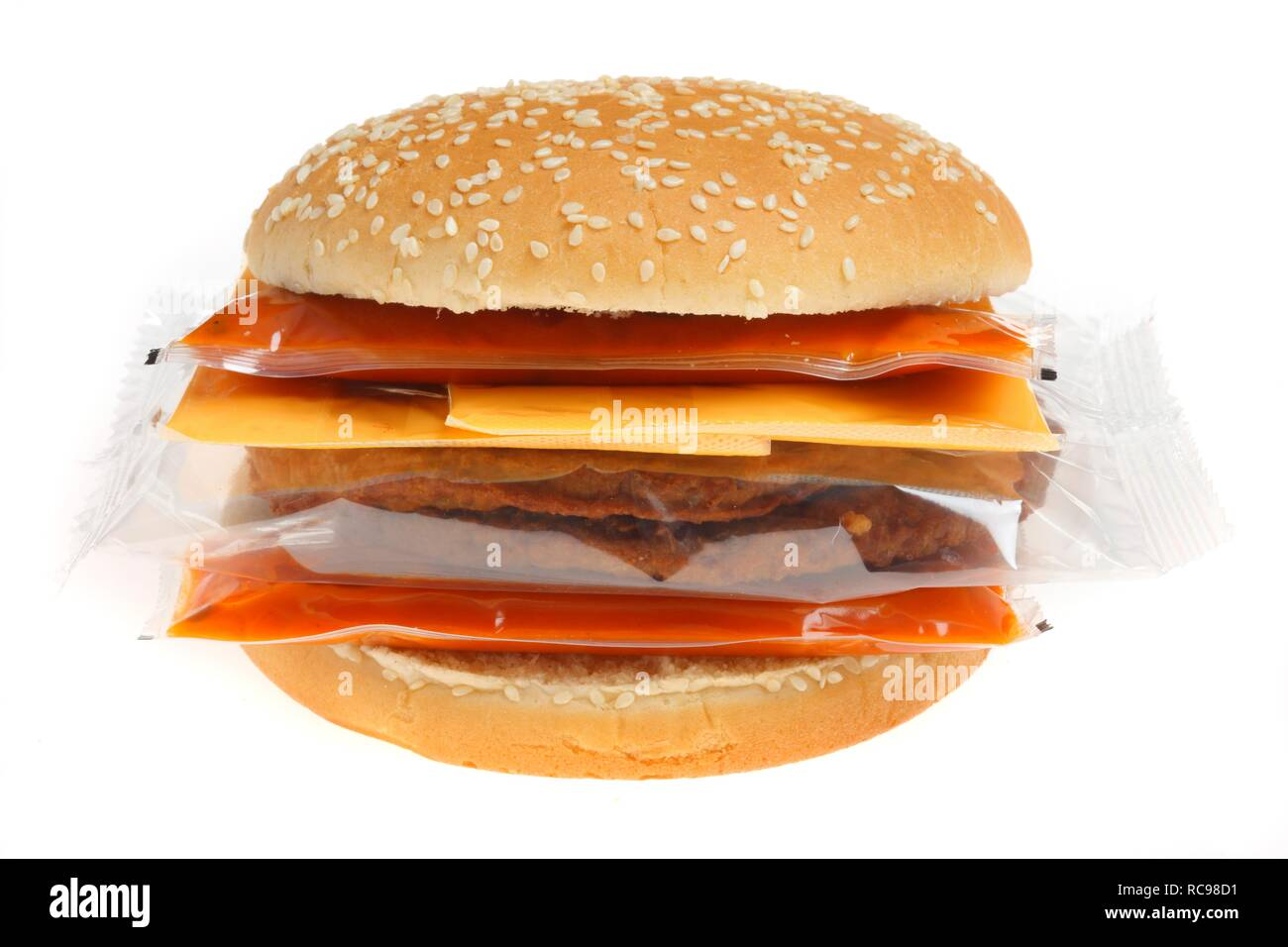 Fast food, individually packaged ingredients from the refrigerator to make your own hamburger with cheese - Stock Image