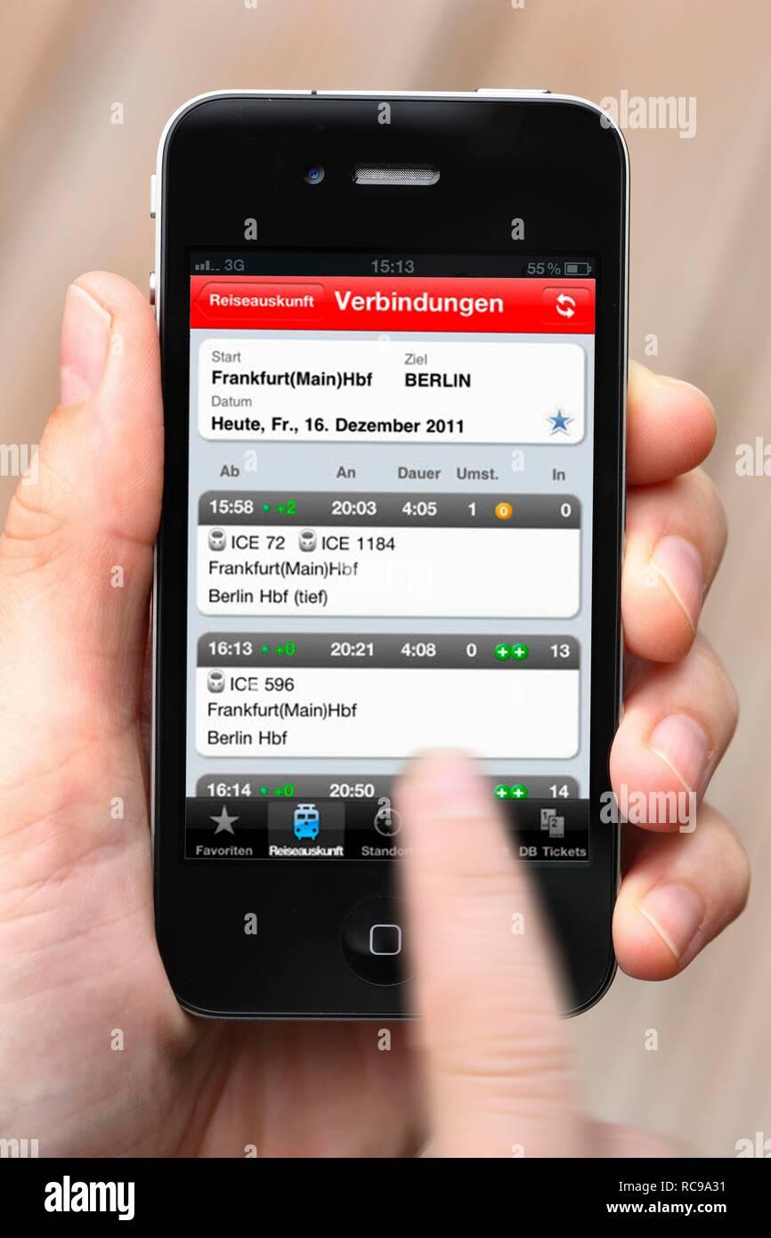 Iphone, smartphone, app on the screen, travel information of Deutsche Bahn, the German national railway company - Stock Image