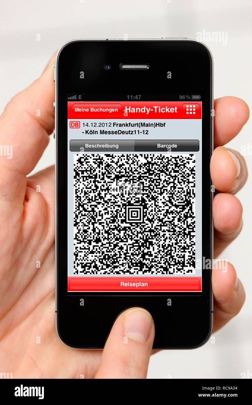 Iphone, smartphone, app on the screen, travel information, QR code-ticket of Deutsche Bahn, the German national railway company - Stock Image