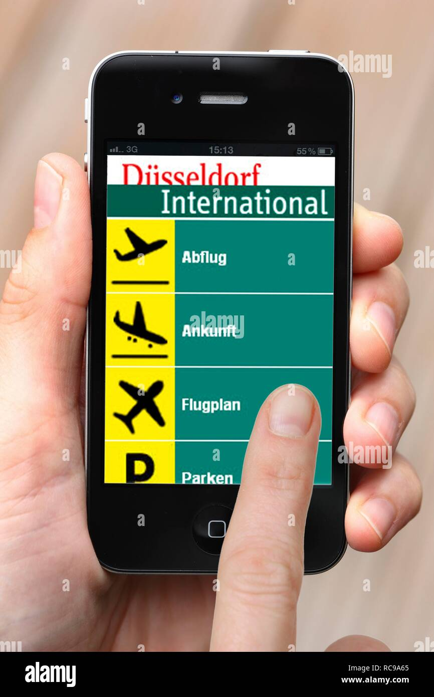 Iphone, smart phone, app on the screen, departures, arrivals, and flight connections, Duesseldorf International Airport - Stock Image