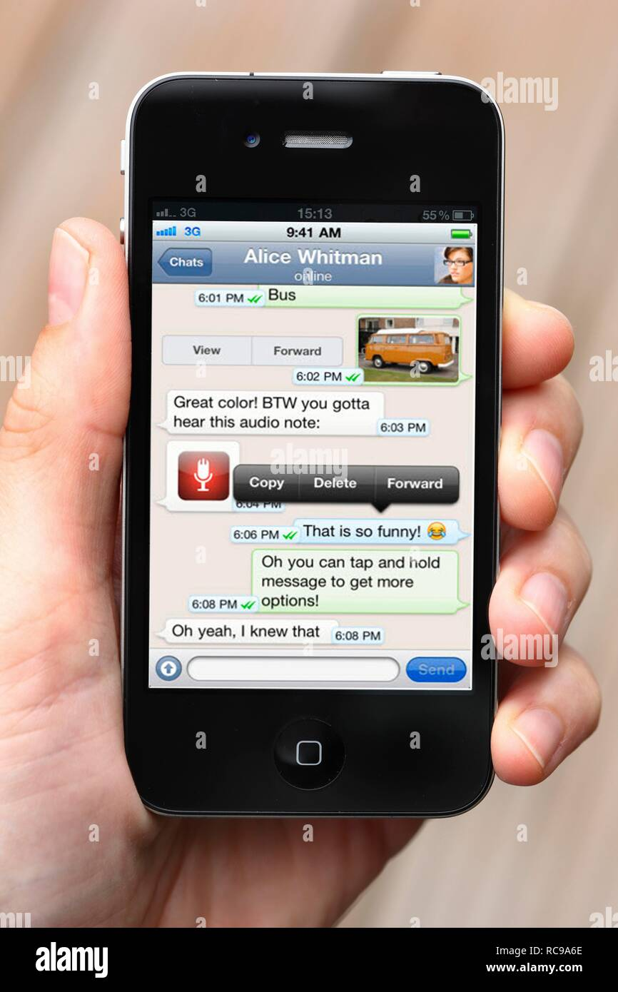 IPhone, smartphone, app on the display, WhatsApp, chat, text messages, messaging service - Stock Image