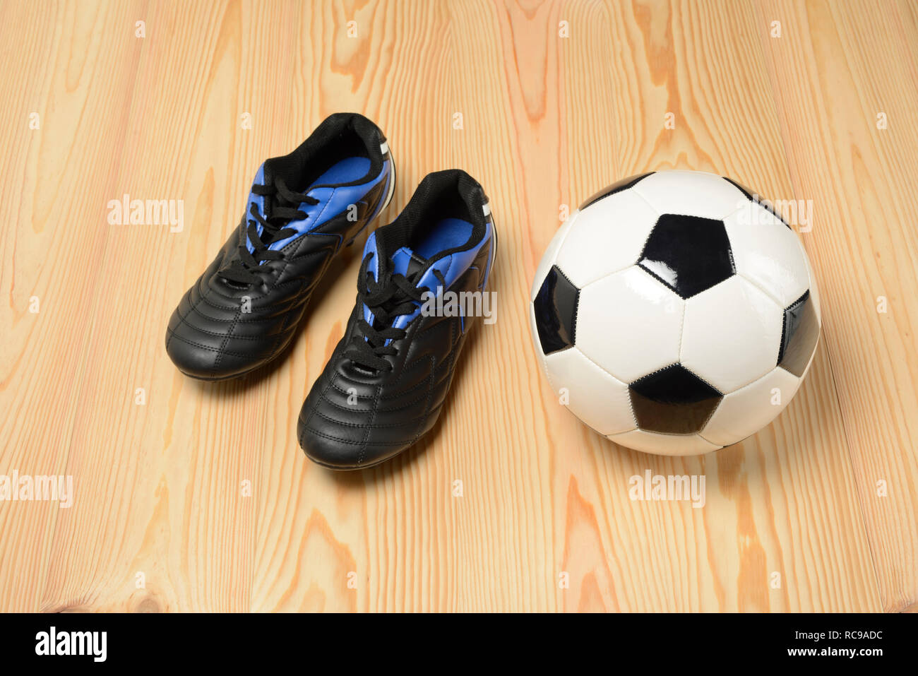 dda1e4c71 Soccer ball and boots on the wooden floor Stock Photo  231316440 - Alamy