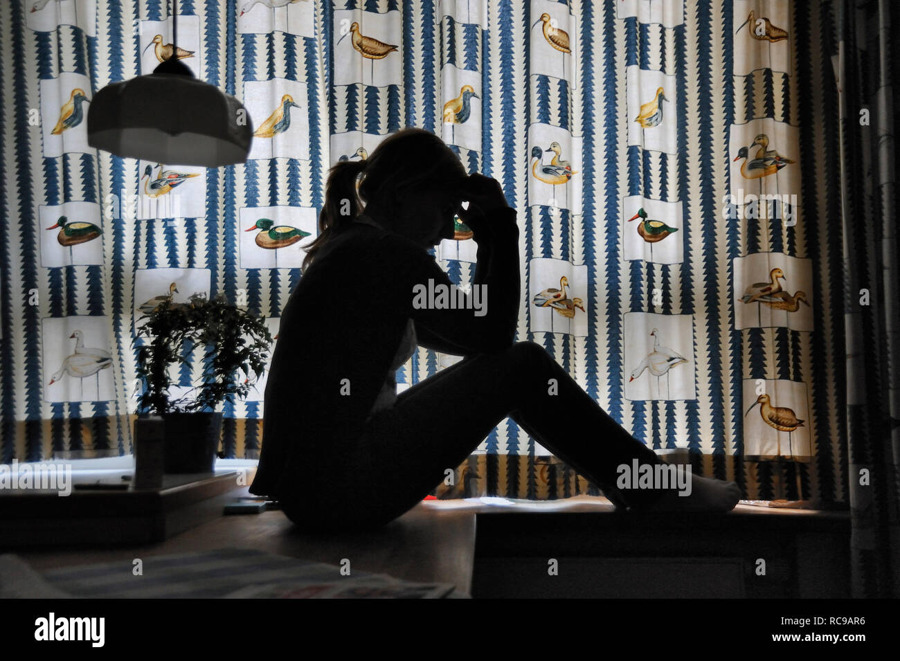 junge Frau nachdenklich, Silhouette | young woman thoughtfull, silhouette - Stock Image