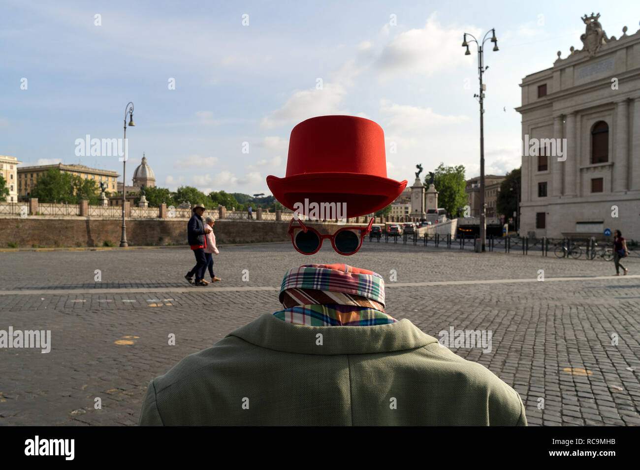 Rome, Italy, 05/06/2018: a street artist simulates an invisible man on the pedestrian area along 'tevere castello' near 'castel sant'angelo'. - Stock Image