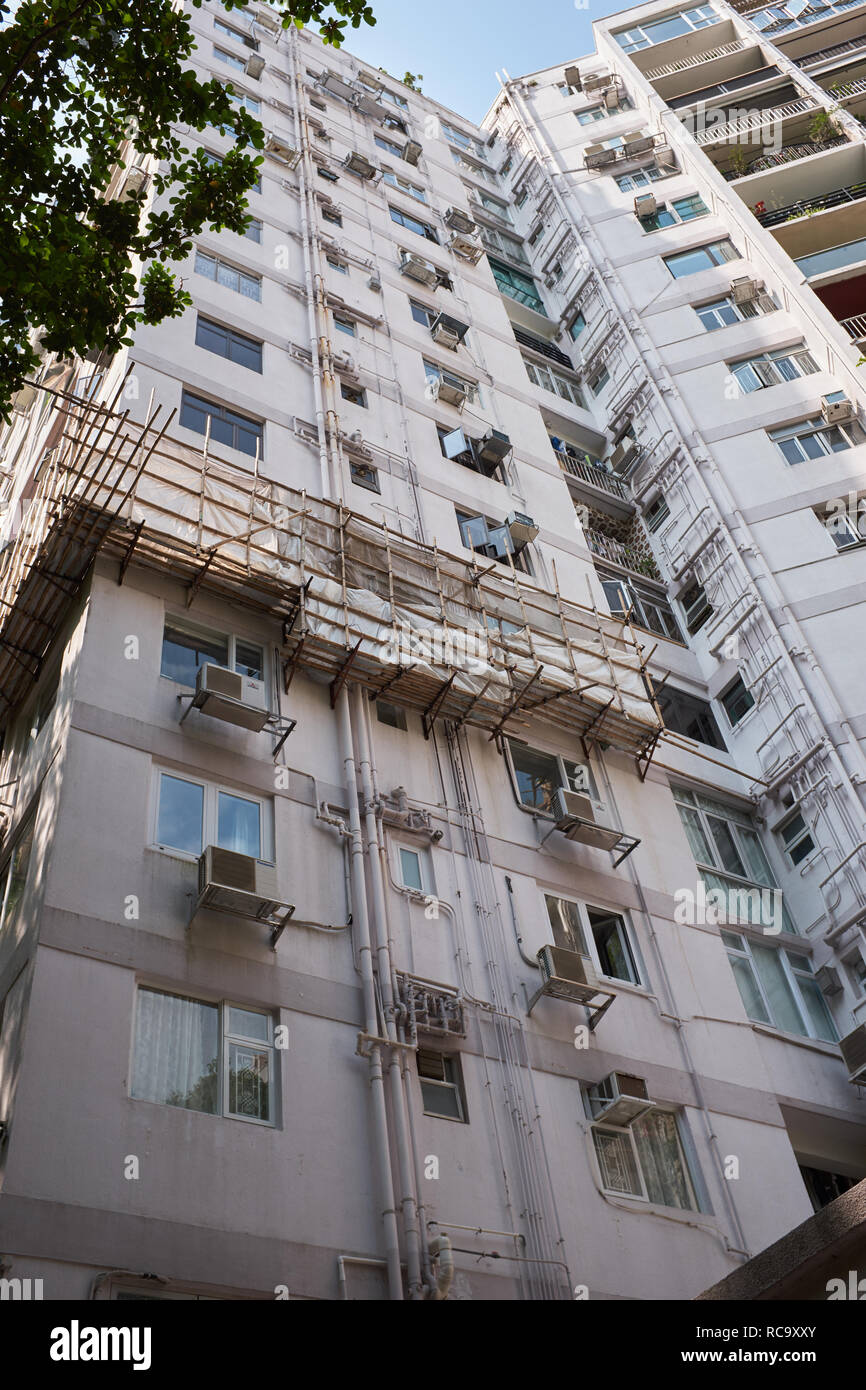 Apartment Building with Bamboo Scaffold - Stock Image