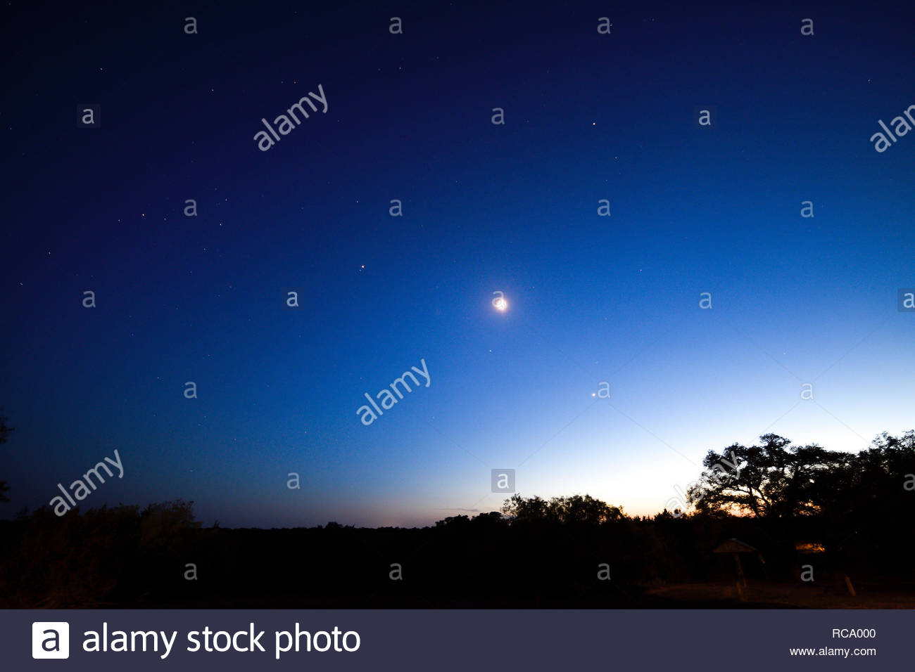 Venus in the evening sky at sunset. The planet Venus appears very bright over the Texas Hill Country at sunset. Venus over Fredericksburg Texas USA - Stock Image