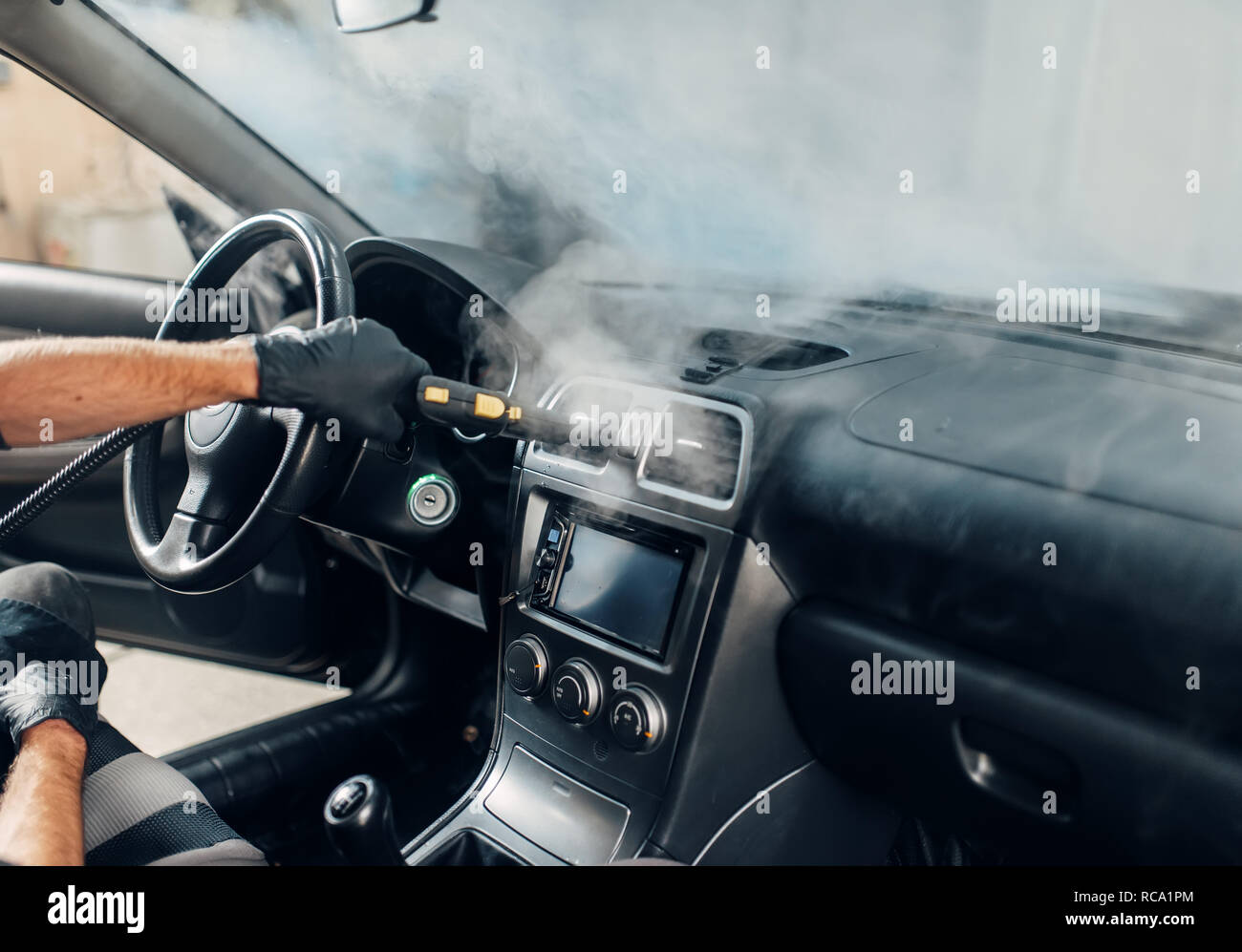 Steam Clean Car Interior >> Carwash Service Male Worker In Gloves Cleans Salon With