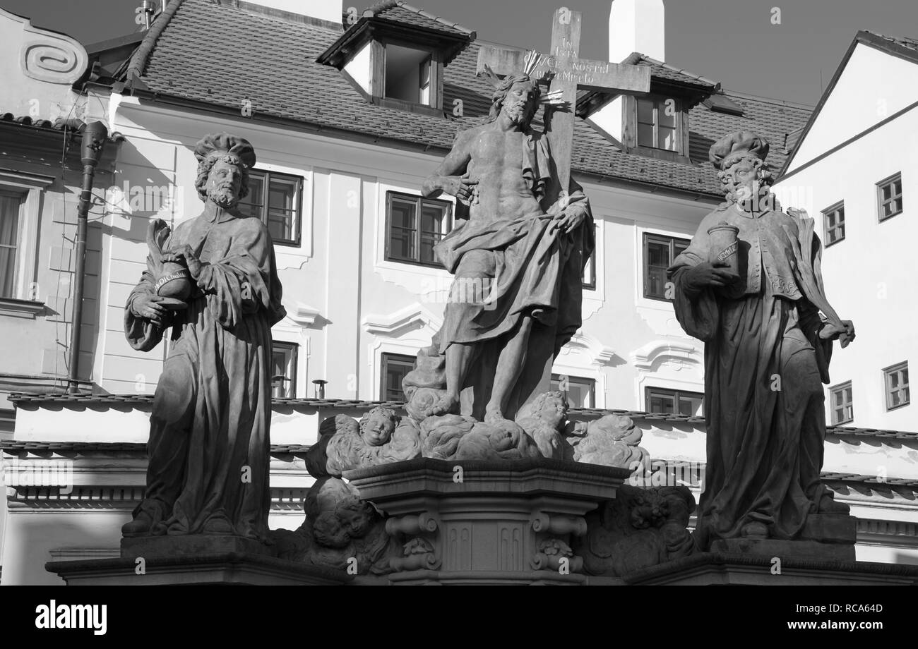 Prague - The baroque staue of st. Cosmos and st. Damian and Christ from Charles bridge by Jan Oldřich Mayer (1666 – 1721). - Stock Image