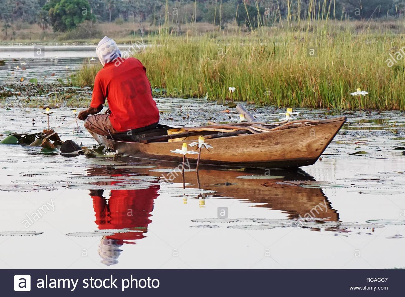 fisherman fishing in a little boat on the lake tengrela in africa, burkina faso Stock Photo