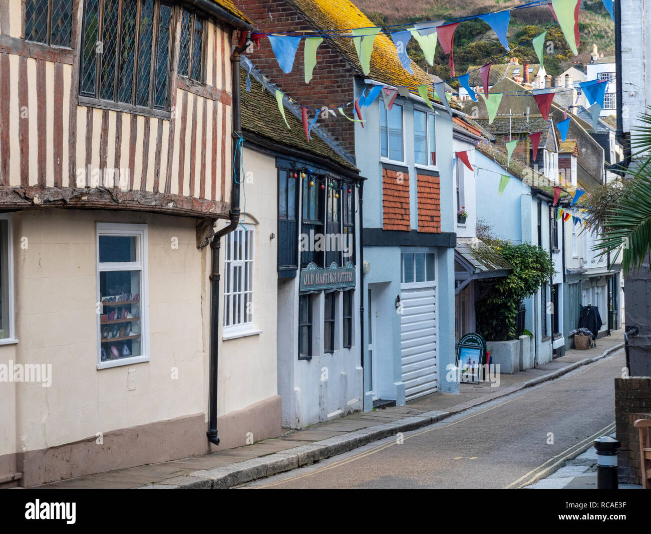 Courthouse Street narrow street with old houses and buildings Hastings Old Town East Sussex UK - Stock Image