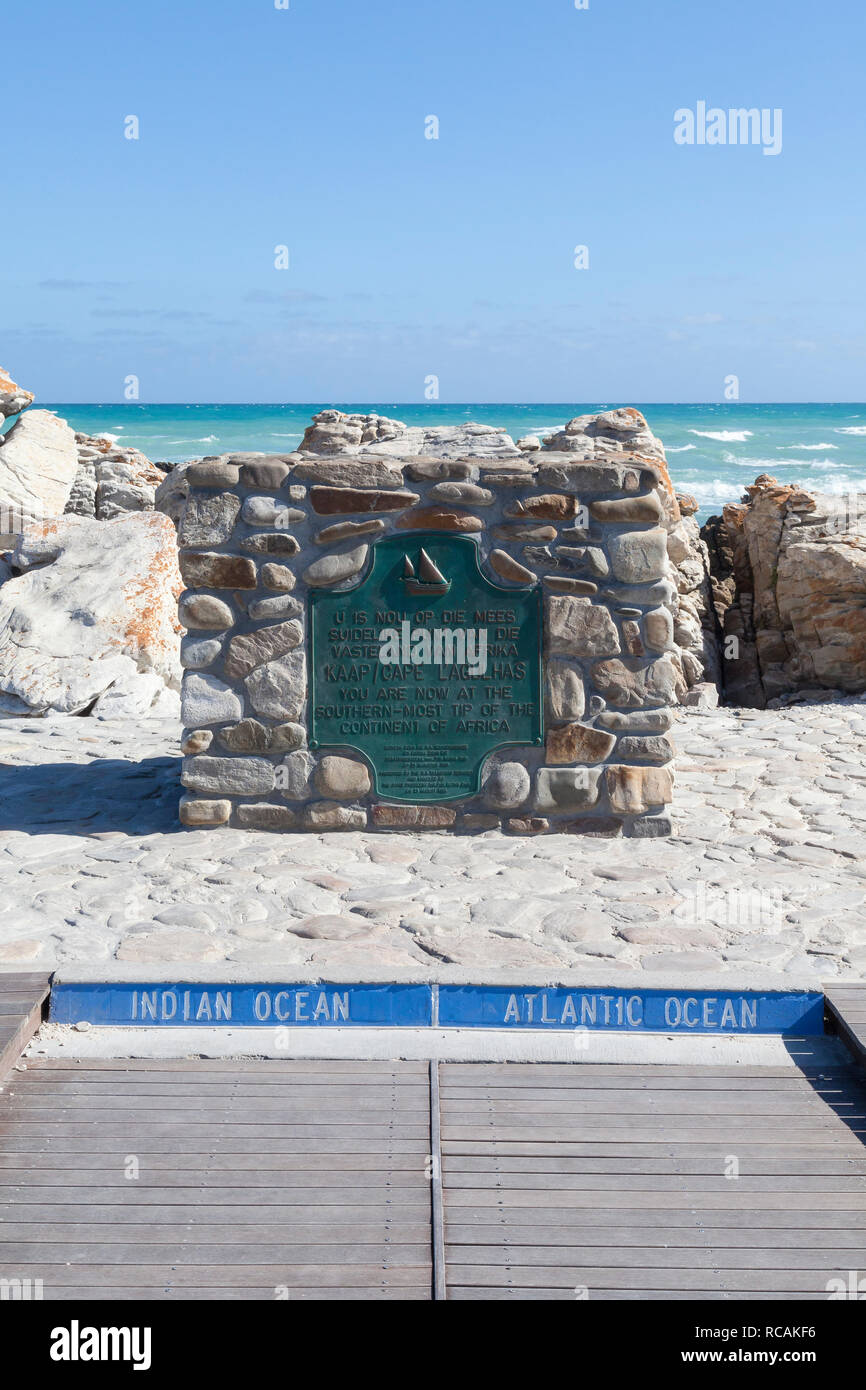 The monument marking the Southernmost tip of Afrrica, Cape Agulhas, Western Cape, South Africa with the meeting of the Atlantic and Pacific oceans - Stock Image