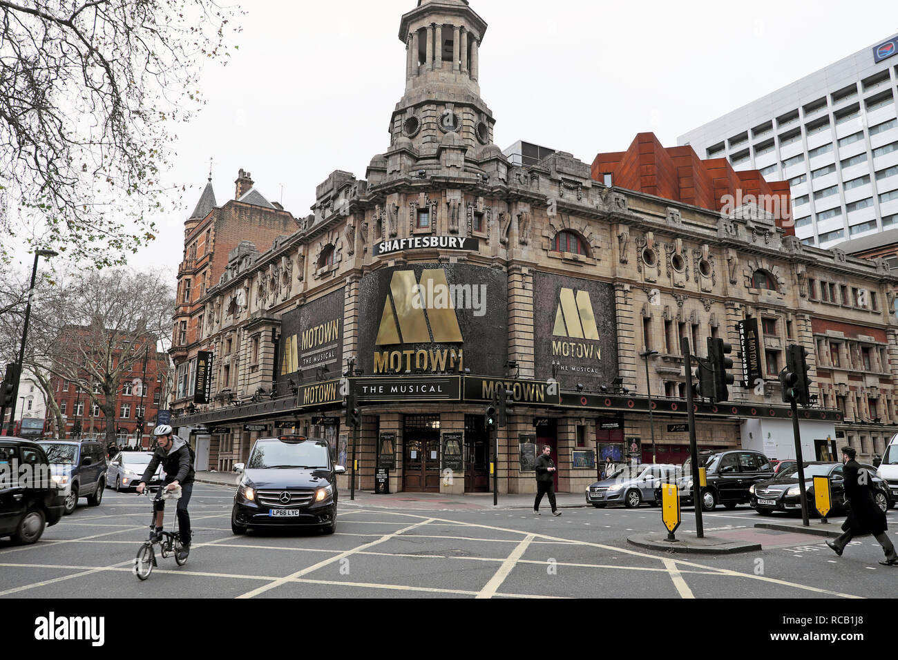 Shaftesbury Theatre featuring Motown the Musical on Shaftesbury Avenue and Brompton bicycle in traffic in London WC2 England UK    KATHY DEWITT - Stock Image