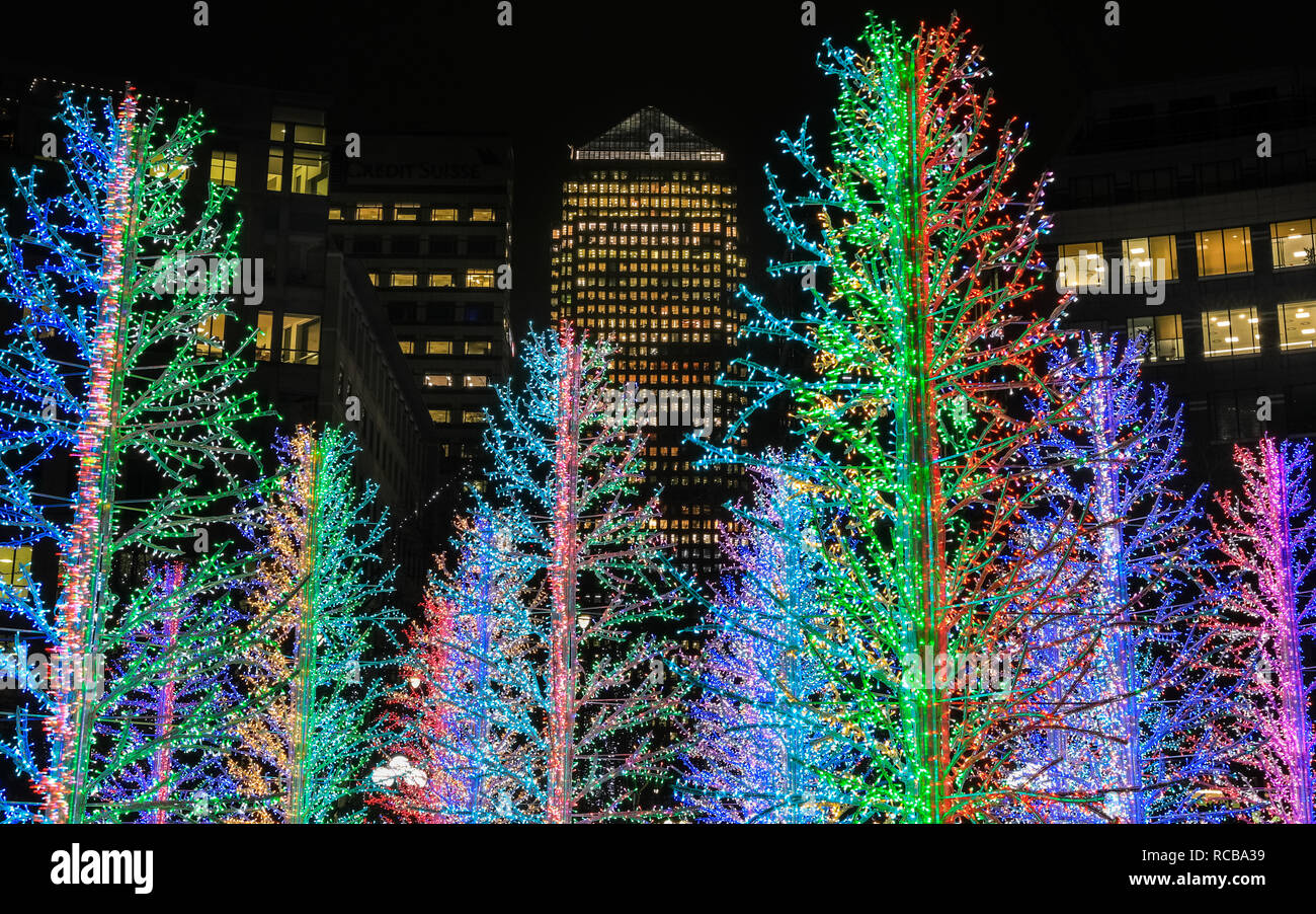 Canary Wharf, London, UK, 14th Jan 2019. The pretty 'Sasha Trees' installation at Westferry Circus. The colourful Canary Wharf Winter Lights installations once again open to public viewing and interactive fun in and around Canary Wharf from Jan 15th until Jan 26th. Credit: Imageplotter News and Sports/Alamy Live News Stock Photo