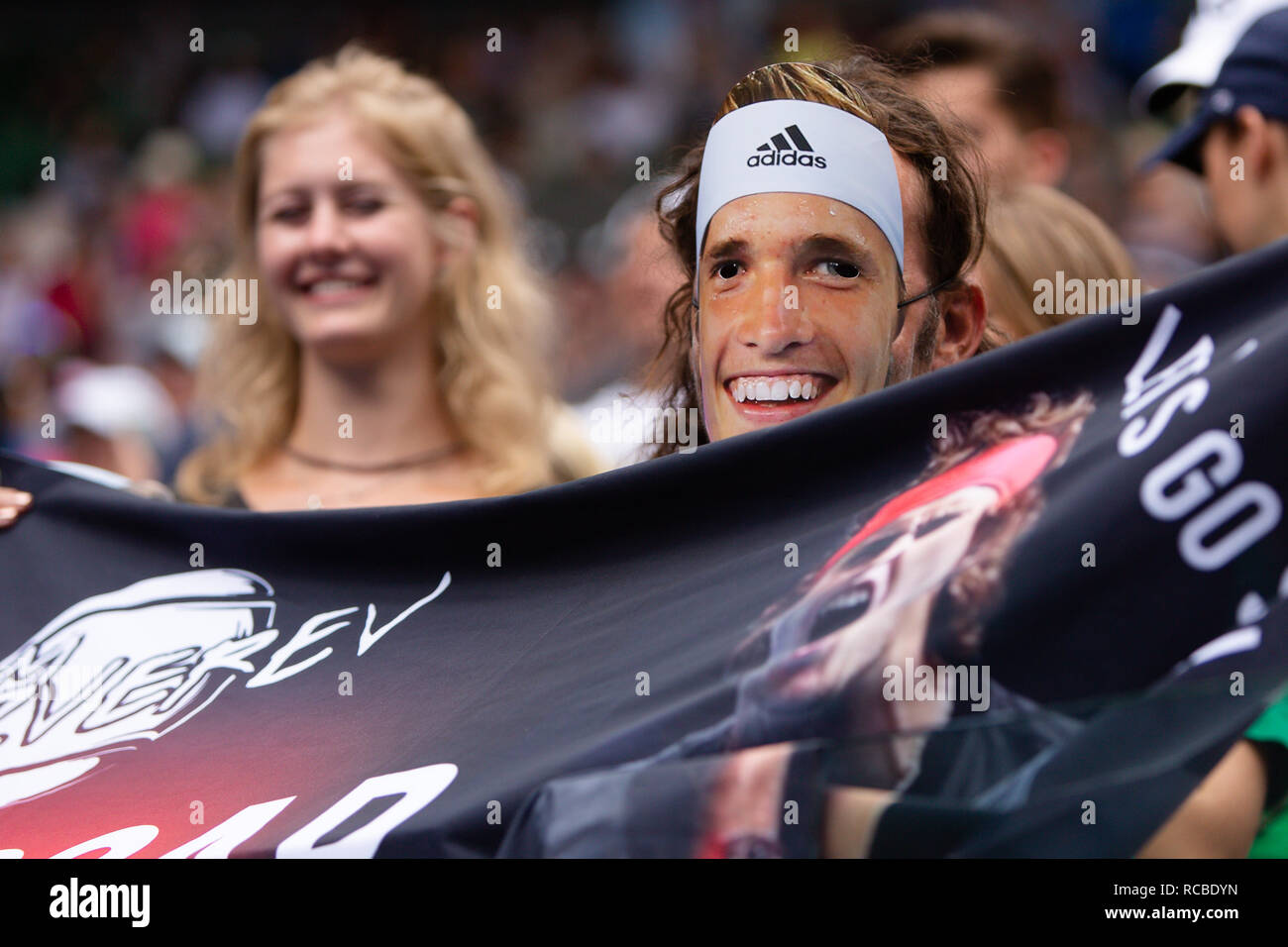 Melbourne, Australia. 15th Jan, 2019. A fan with Alexander Zverev mask cheers for the german player during his1st round match at the 2019 Australian Open Grand Slam tennis tournament in Melbourne, Australia. Frank Molter/Alamy Live news Stock Photo