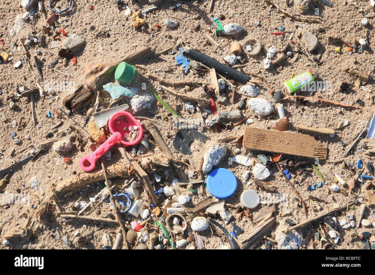 Beirut, Lebanon. 15th January 2019. Hundreds of plastic objects including consumer items are abandoned and washed on a public beach in South Beirut. It is estimated that 1.1 to 8.8 million metric tons (MT) of plastic waste enters the ocean from coastal communities each year and marine animals have been  harmed by  entanglement in plastic objects Credit: amer ghazzal/Alamy Live News - Stock Image