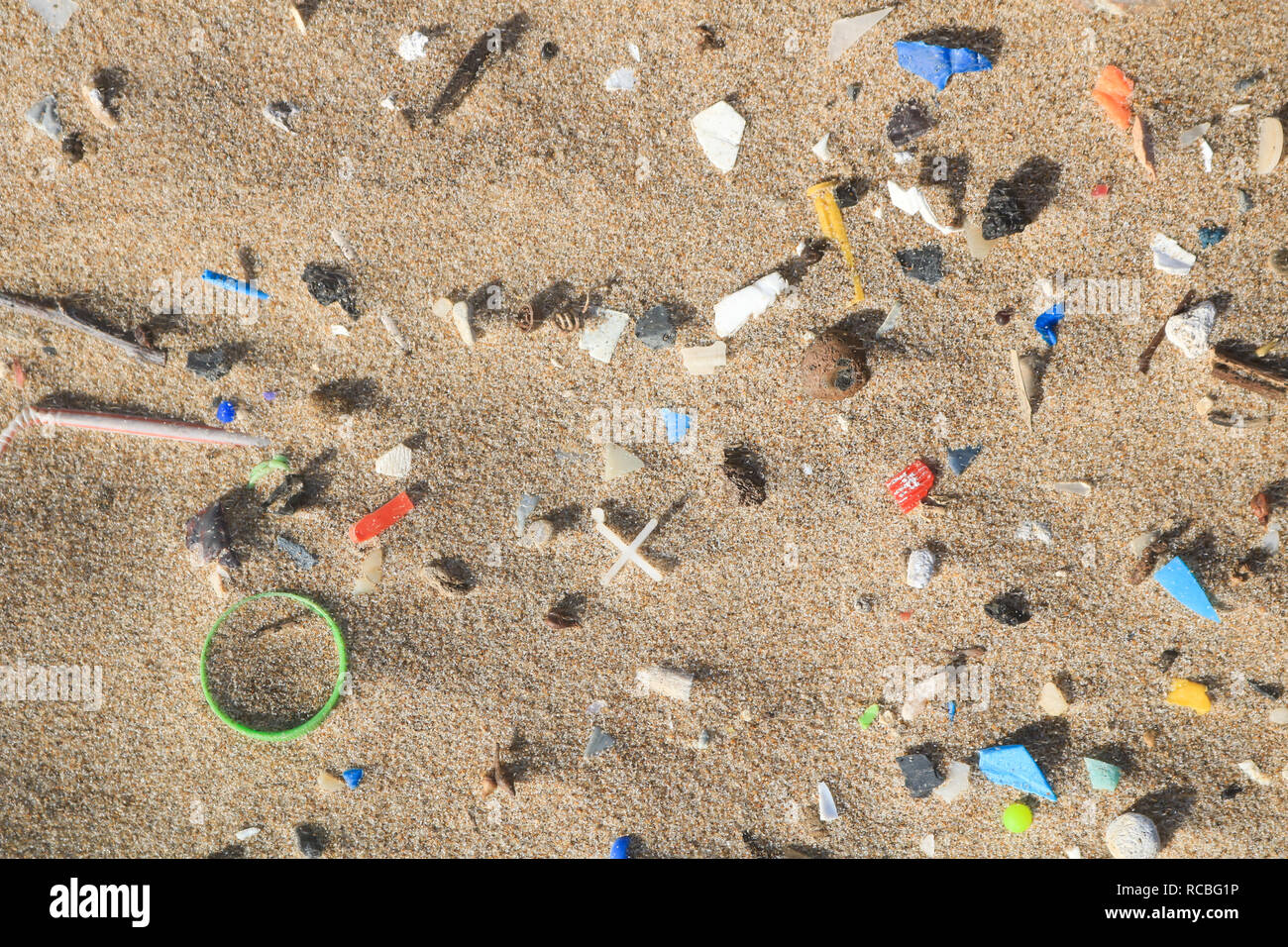Beirut, Lebanon. 15th January 2019. Hundreds of micro plastic objects  are accumulated on a public beach in South Beirut. It is estimated that 1.1 to 8.8 million metric tons (MT) of plastic waste enters the ocean from coastal communities each year and marine animals have been  harmed by  entanglement in plastic objects Credit: amer ghazzal/Alamy Live News - Stock Image