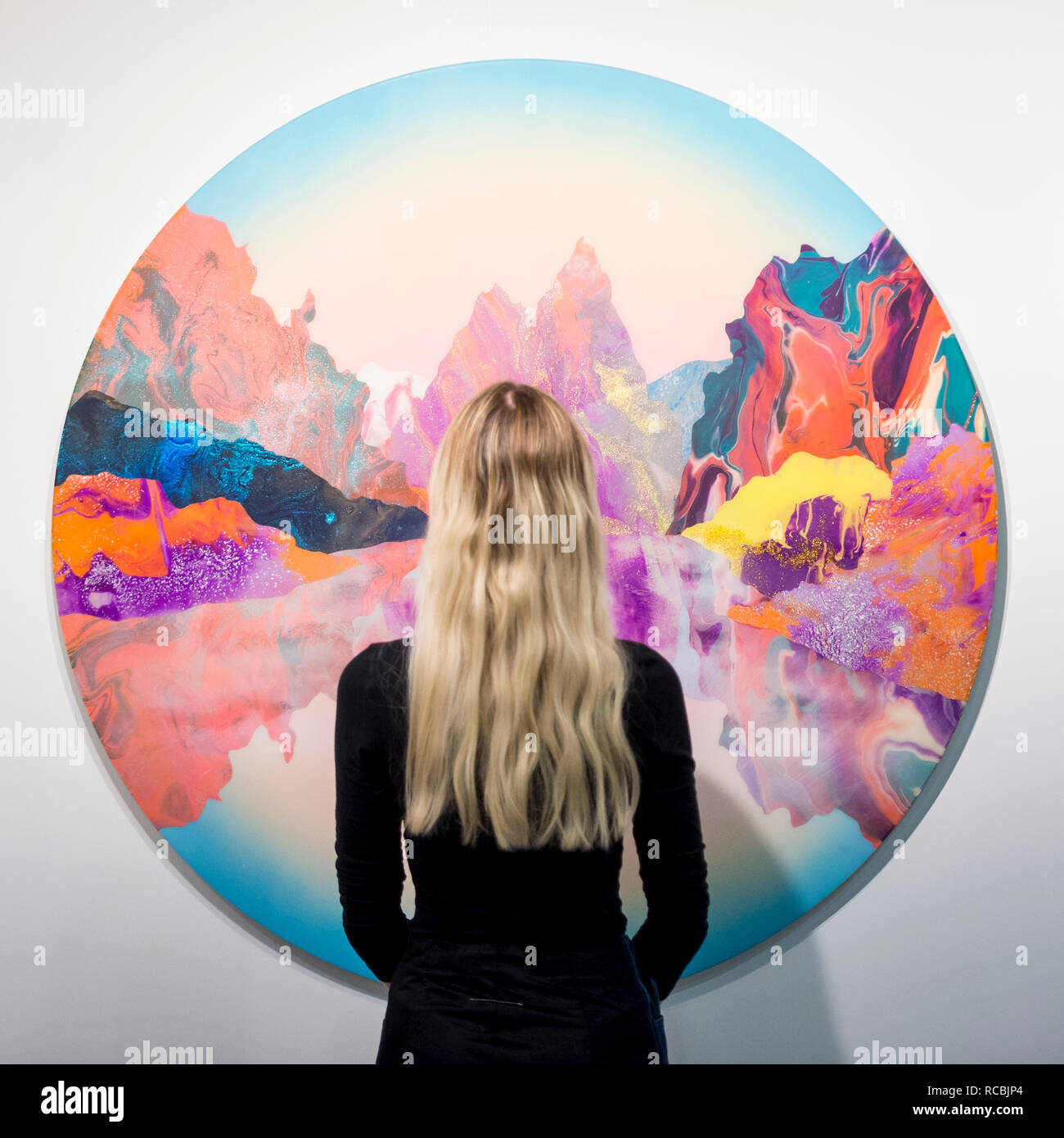 London, UK.  15 January 2019.  A staff member views 'Earth intruders', 2018, by Kate Shaw at the Cube gallery stand.  Preview of London Art Fair 2019 at the Business Design Centre in Islington.  The annual fair showcases exceptional modern and contemporary art from the 20th century to present day and opens 16 to 20 January.  Credit: Stephen Chung / Alamy Live News - Stock Image