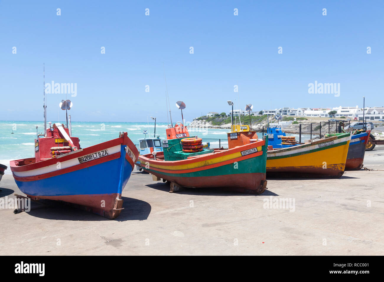 Colourful old wooden fishing boats on the slipway  in the fishing village of Arniston, Agulhas, Western Cape, South Africa, a popular tourist destinat Stock Photo