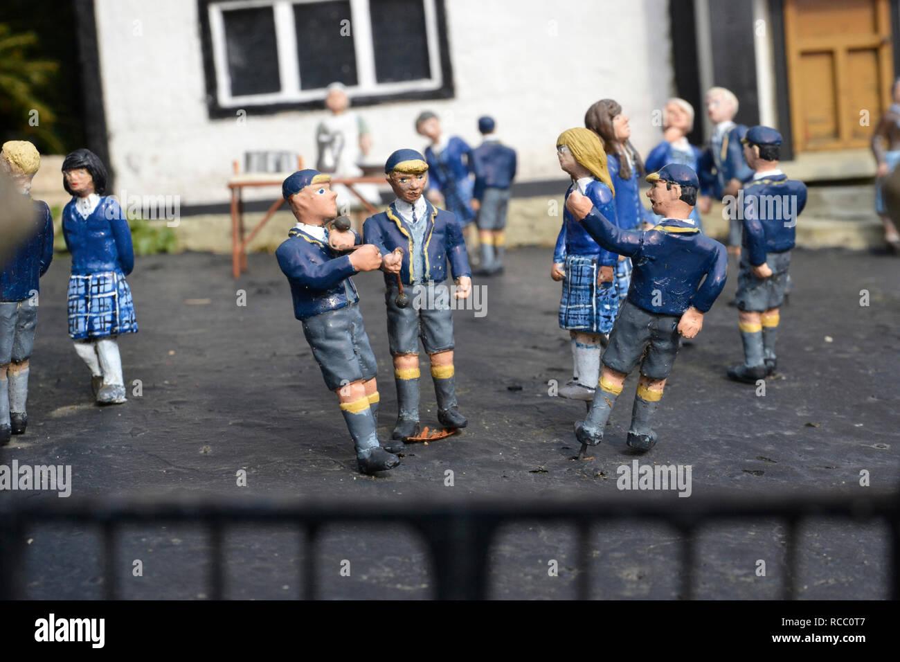 School children over the school gate at Beaconscot Model Village, Beaconsfield, Buckinghamshire, UK - Stock Image