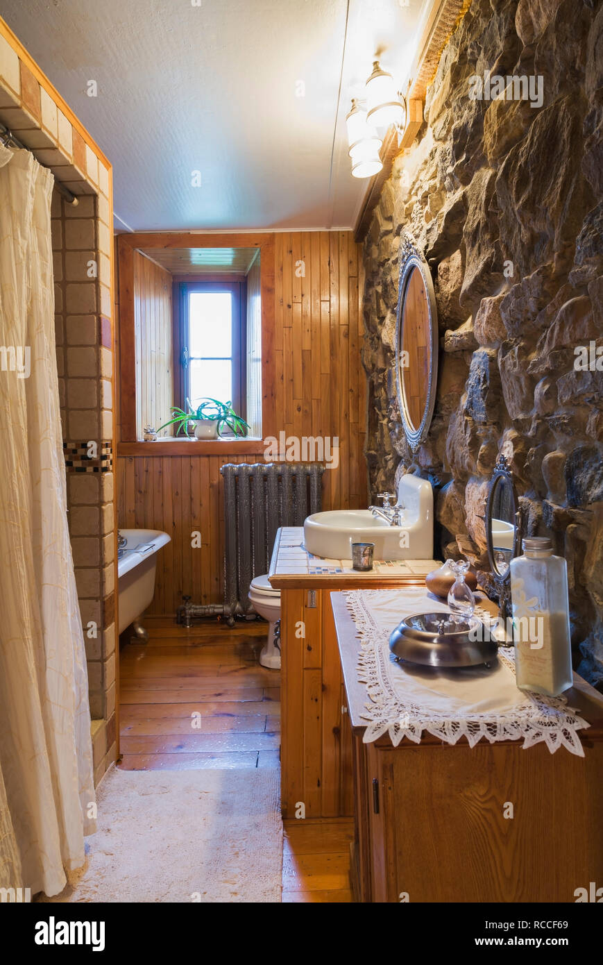 Main Bathroom With Claw Foot Bathtub And Ceramic Shower
