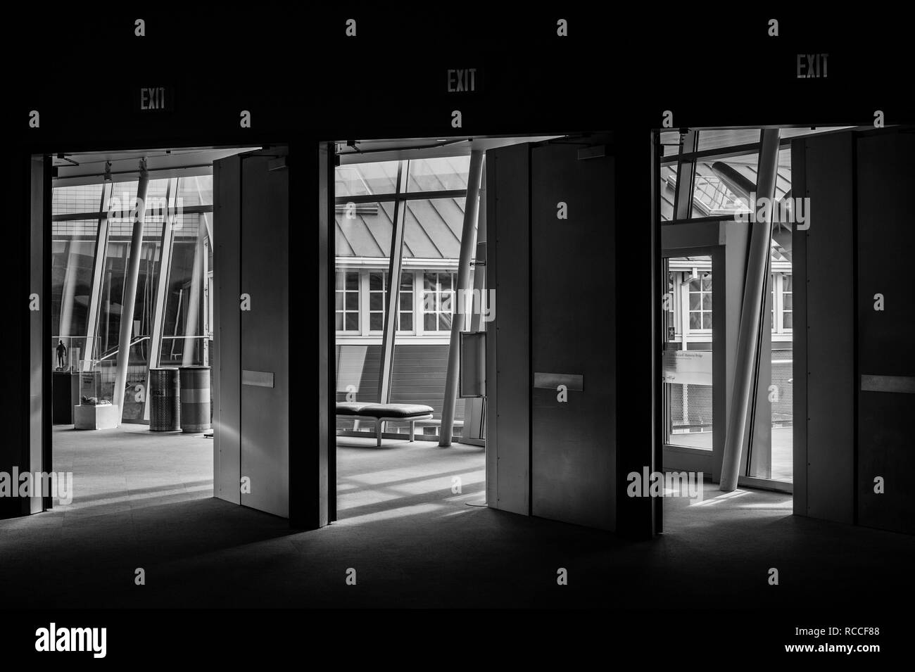 Interior image of doors with exist lights above at the Boeing Museum of Flight - Stock Image