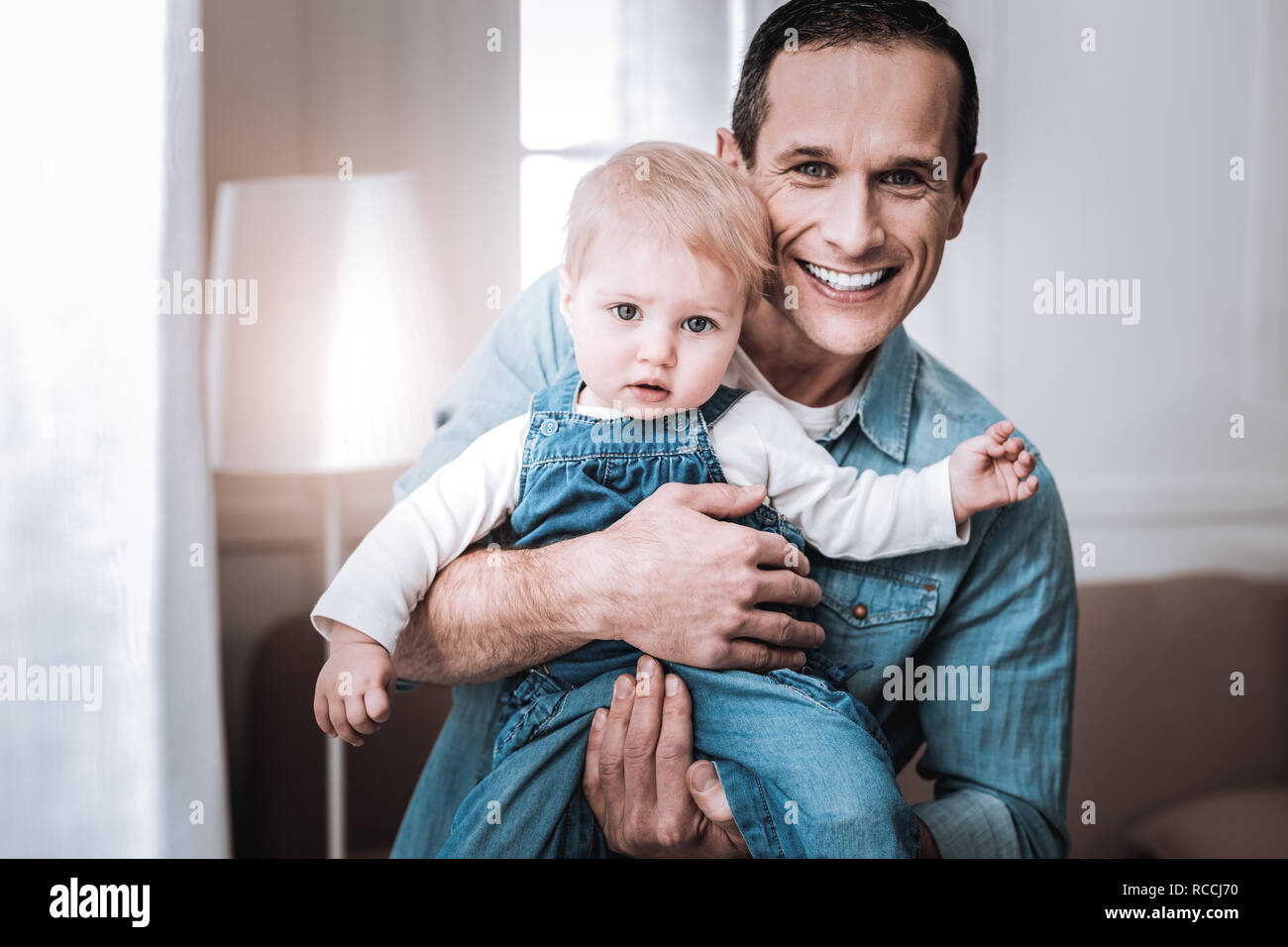 Happy joyful father looking at you - Stock Image