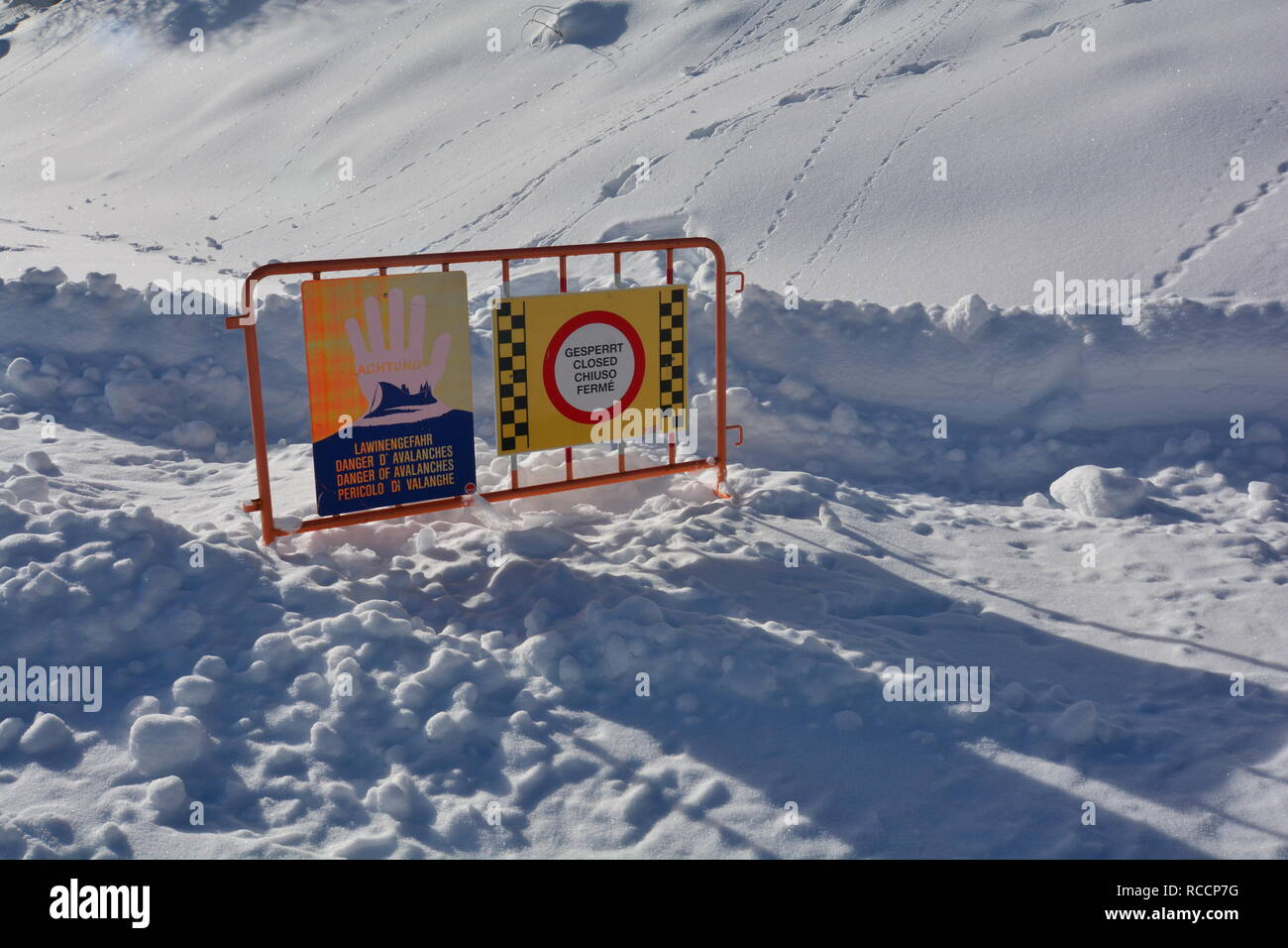 Avalanche danger sign. Closed road due to avalanche danger in the Austrian Alps. Massive snowfall in central Europe. - Stock Image