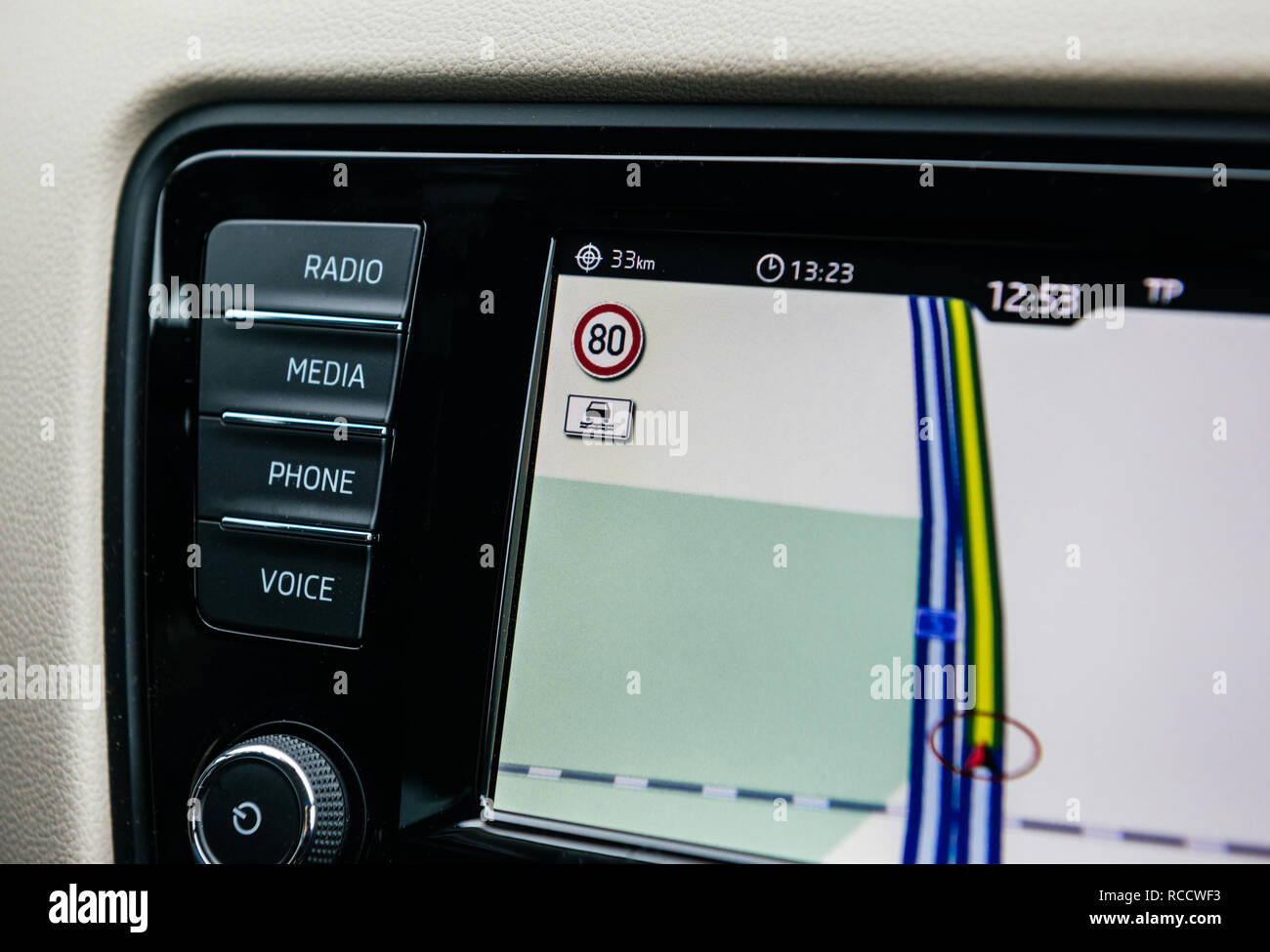 FRANKFURT, GERMANY - FEB 2, 2018: Car GPS infotainment display system showing lanes speed limit to 80KMH and wet road sign of a German autobahn on the digital map Stock Photo