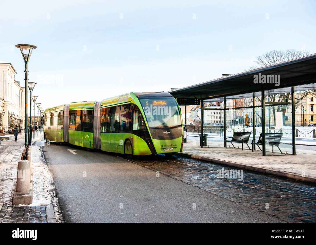 MALMO, SWEDEN - 29 DEC 2014: double articulated bus Van Hool 324H Exequicity 24 Hybrid operated by Skanetrafiken arriving in bus station on a cold winter day - ecologic public transportation line 5 in Malmo  - Stock Image