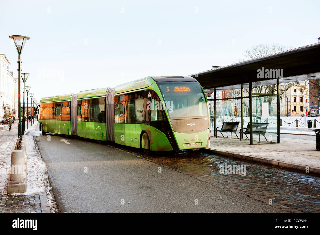 MALMO, SWEDEN - 29 DEC 2014: Green articulated bus Van Hool 324H Exequicity 24 Hybrid operated by Skanetrafiken arriving in bus station on a cold winter day - ecologic public transportation line 5 in Malmo  - Stock Image