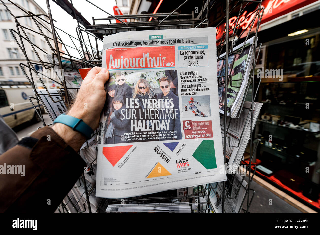 PARIS, FRANCE - MAR 15, 2018: French Aujourd'hui magazine with portrait of French singer Johnny Hallyday during the money dispute scandal   - Stock Image