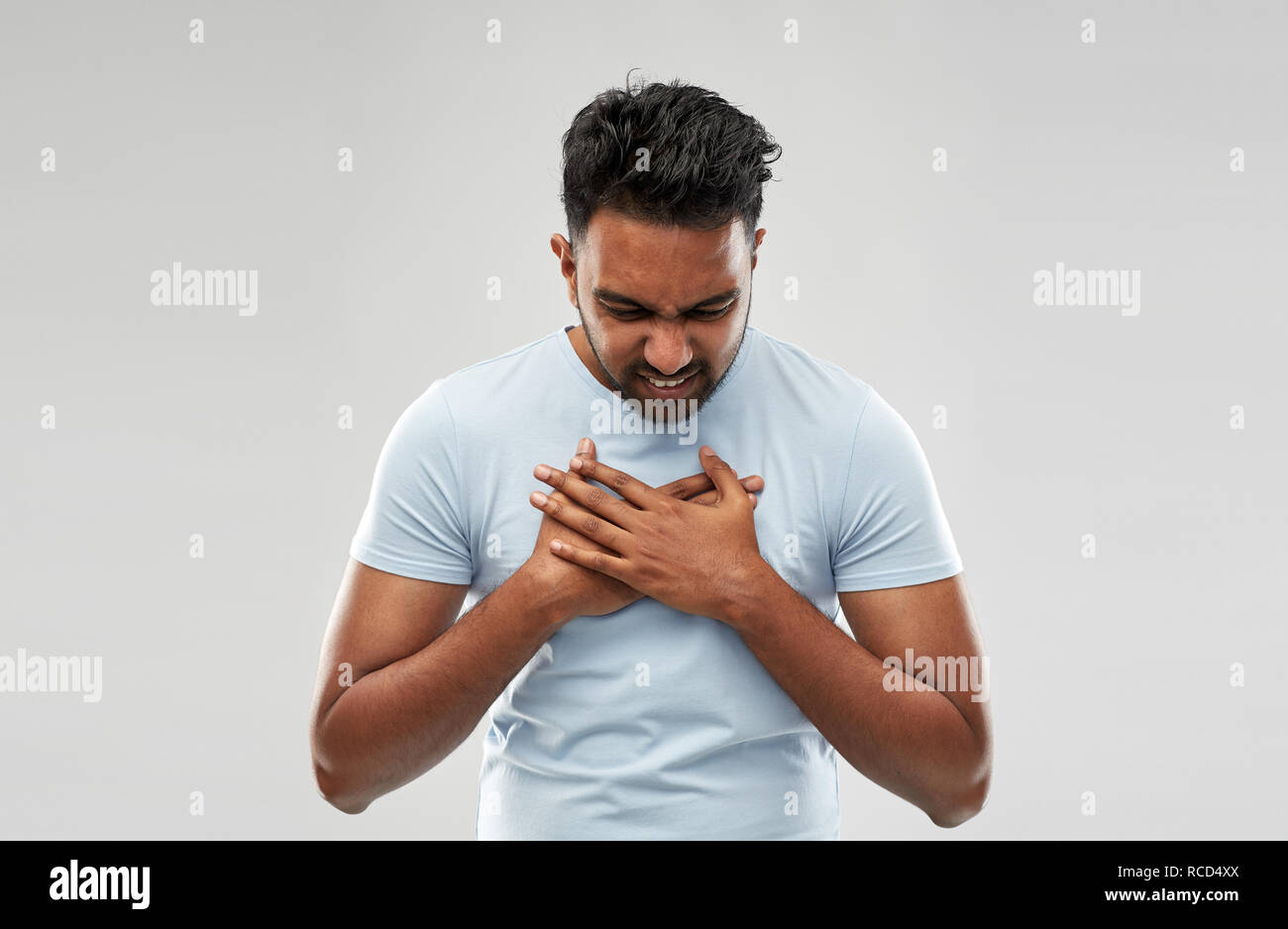 unhappy man suffering from heartache - Stock Image