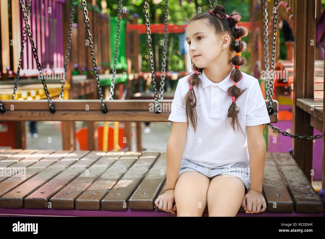 child girl at the playground - Stock Image