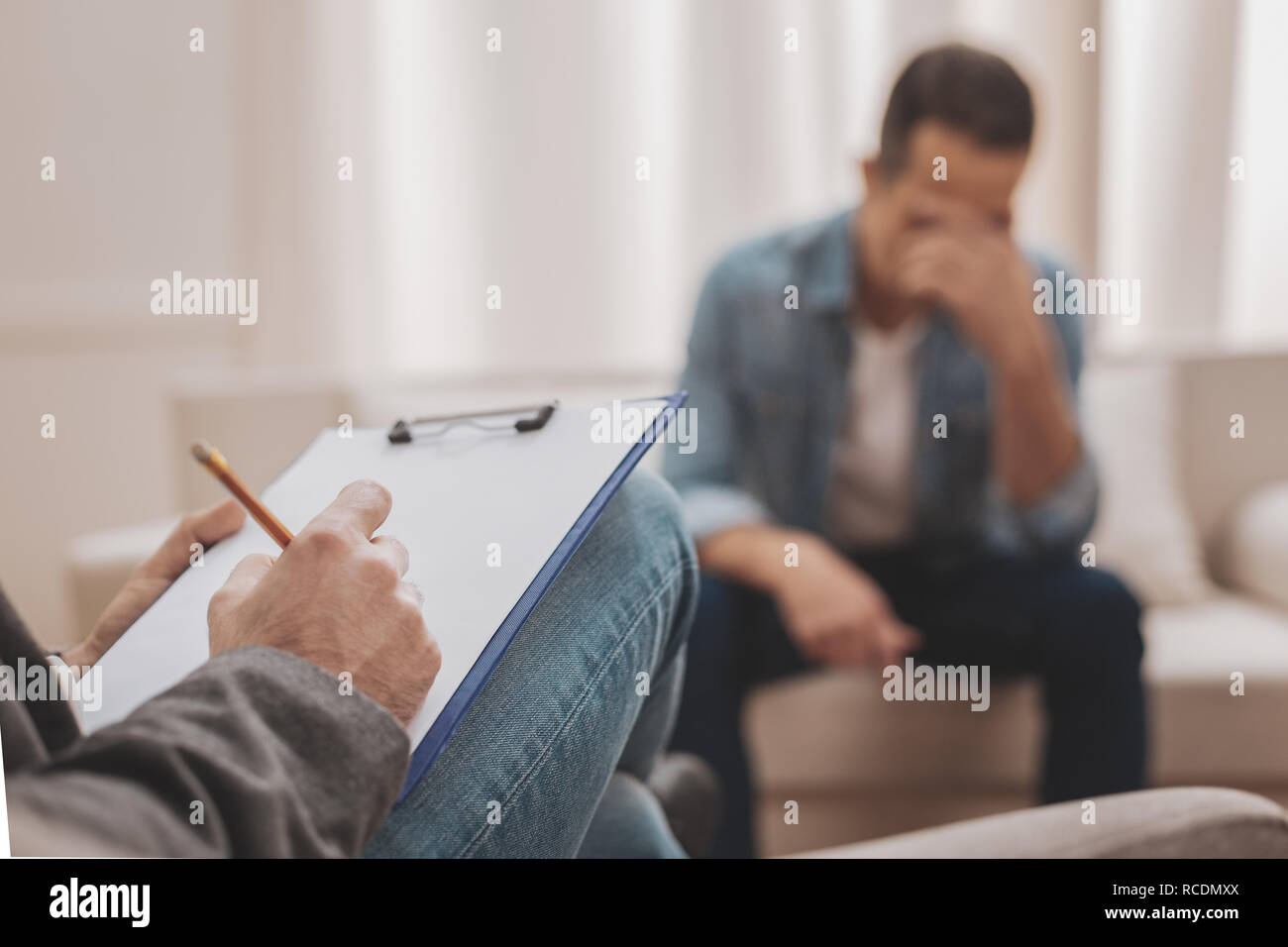 Qualified therapist searching the solution for depression - Stock Image