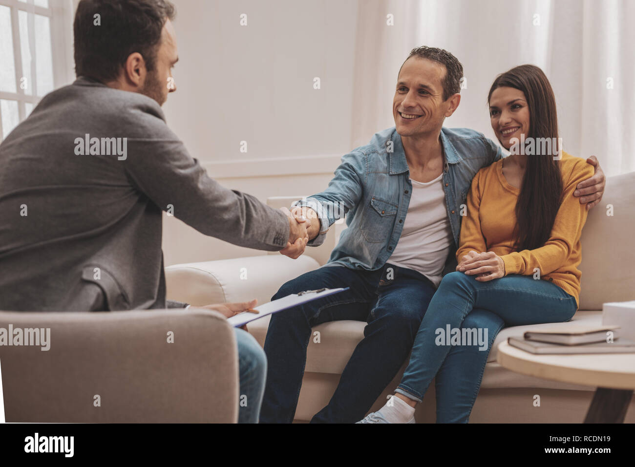 Happy man feeling satisfied after family relations session - Stock Image