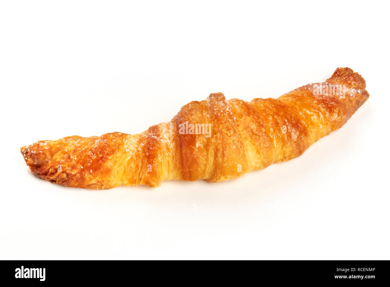 A photo of a croissant on a white background with a place for text - Stock Image