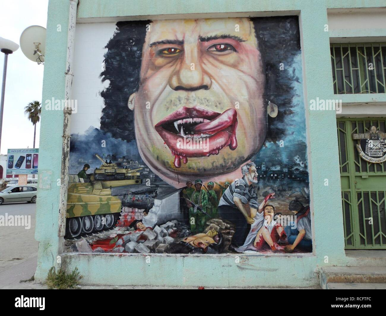 Al Bayda caricatures of Gadafi. - Stock Image