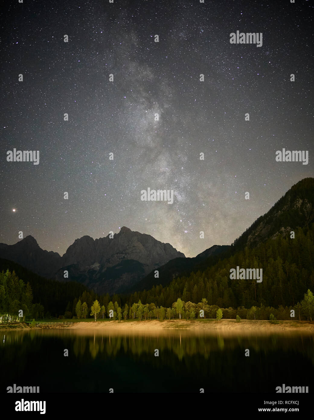 View of the Milky Way over Jasna Lake and the Julian Alps, near Kranjska Gora, Gorenjska, Slovenia - Stock Image