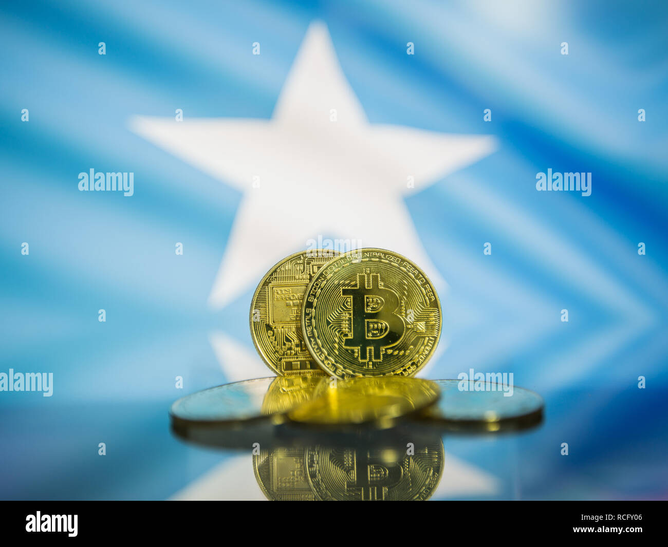 Bitcoin gold coin and defocused flag of Somalia background. Virtual cryptocurrency concept. - Stock Image